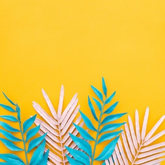 Exotic tropical leaves on yellow