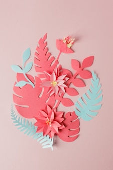 Exotic tropical multicolored leaf paper composition, creative application handcraft on a pink