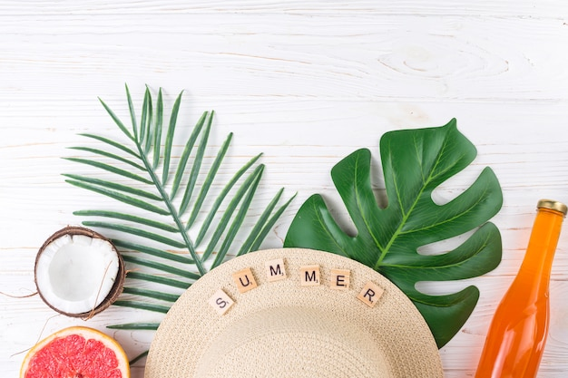 Exotic vacation arrangement of fruit and beach hat