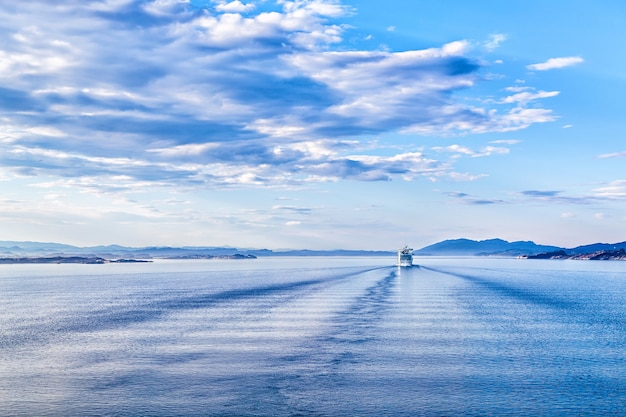 Expanse of the sea and the ship sailing away