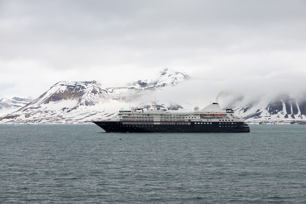 Expedition ship in arctic sea, svalbard. passenger cruise vessel. arctic and antarctic cruise.