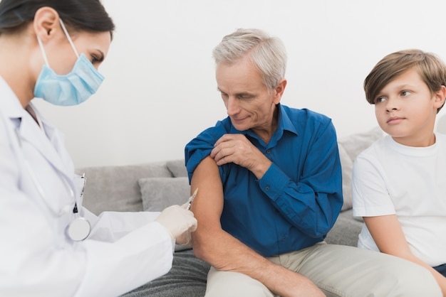 Experienced doctor makes insulin injection to grandfather.