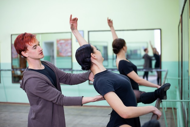 Experienced instructor helping to master their dancing skills and become better ballet dancers