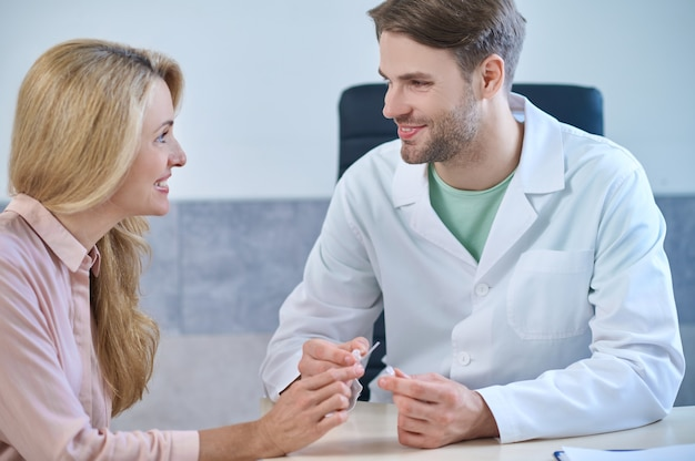 Experienced medical professional giving a consultation to his patient