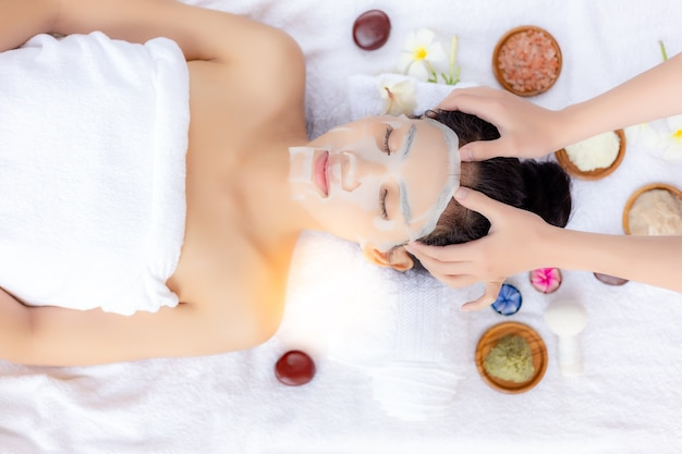 Expert massage is massaging on her head, make beautiful woman relieve stress from work