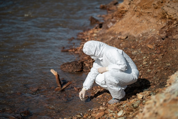 Experts analyze the water in a contaminated environment.