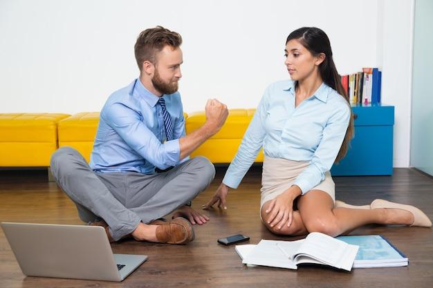 Explaining profession sitting teamwork cooperation