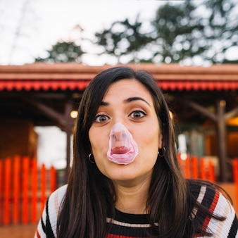Exploded bubble gum on girl's face