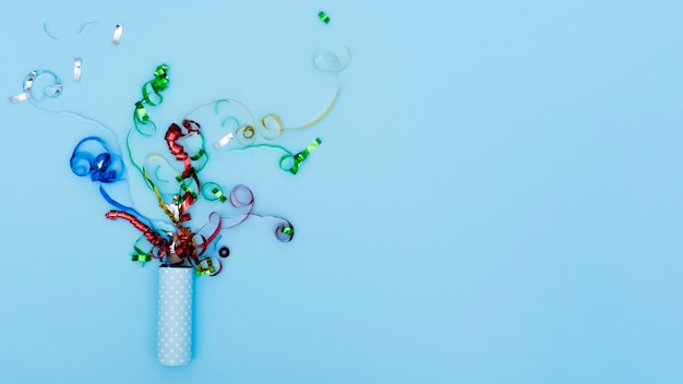 Exploding party popper with serpentine confetti