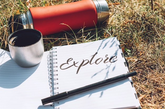 Explore lettering word written in white notebook