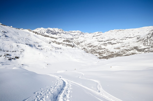 Exploring the alps by ski touring, snow capped mounatins