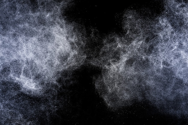 Explosion of blue powder on black background
