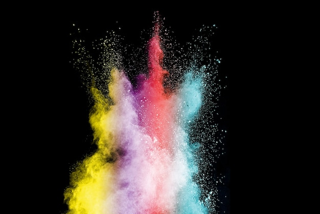 Explosion of colored powder on black