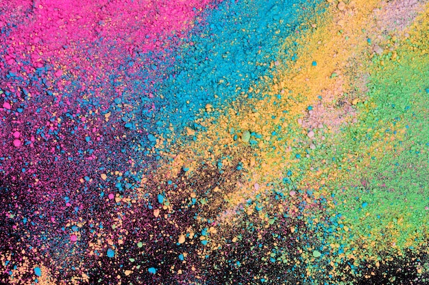 An explosion of colorful pigment powder on black background.
