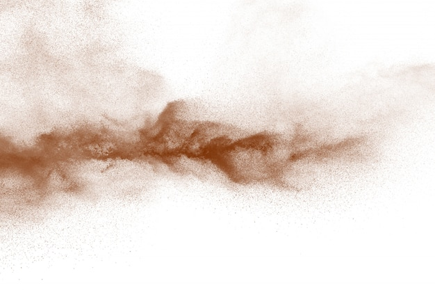 Explosion of deep brown powder on white background.