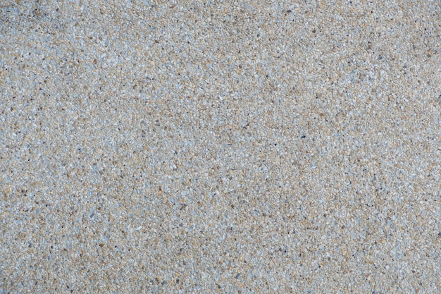 Explsed aggregate finish concrete wall and floor background texture.