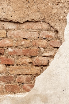 Exposed brick wall with cement and stones