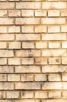 Exposed dirty brick wall