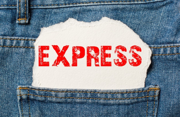 Express on white paper in the pocket of blue denim jeans