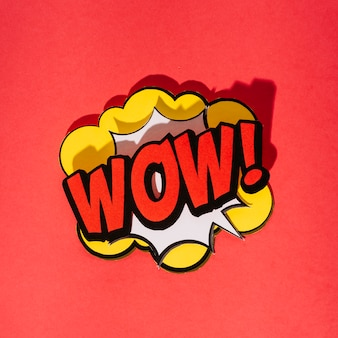 Expression text wow in the center of speech bubble on red background