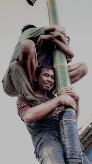 The expression of a young boy playing greasy pole