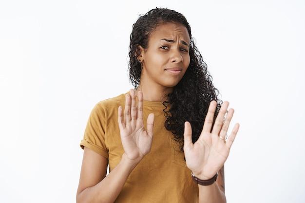 Expressive african-american girl in brown tshirt