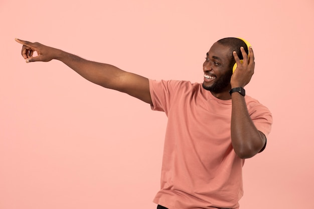 Expressive african american man listening to music on headphones
