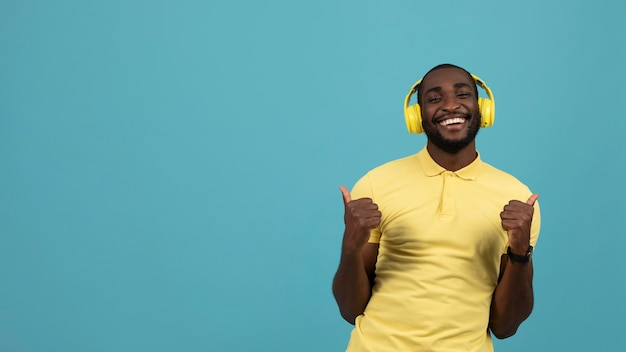 Expressive african american man listening to music