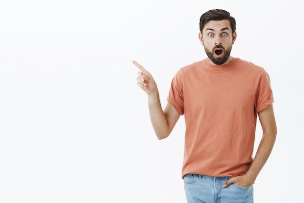Expressive bearded man in orange tshirt