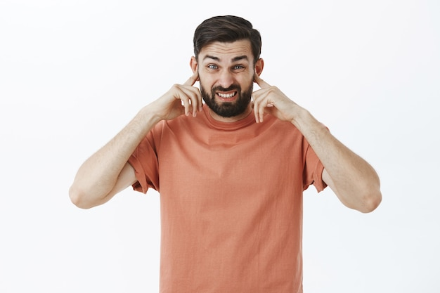 Expressive bearded man in orange tshirt