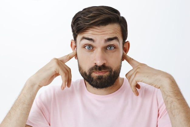 Expressive bearded man in pink tshirt
