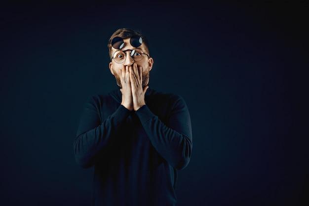Expressive man in flip glasses