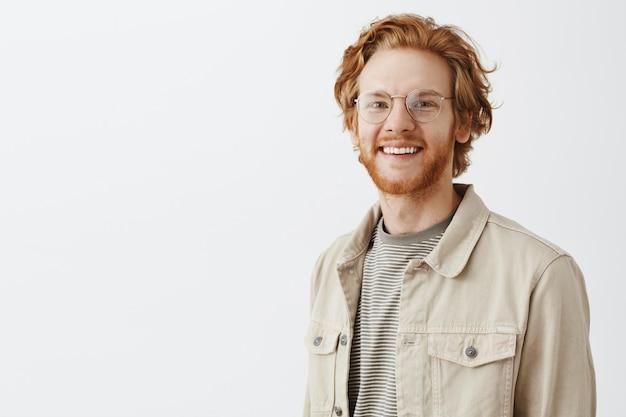 Expressive redhead guy in beige shirt