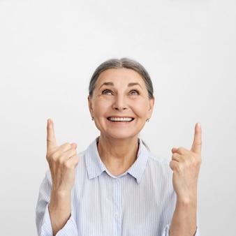 Expressive senior woman posing
