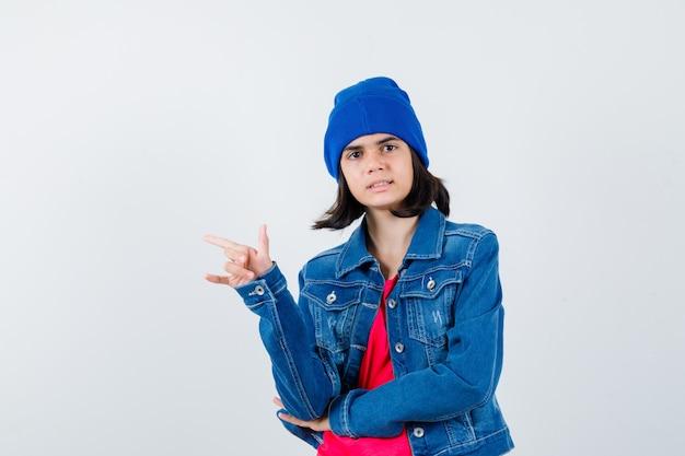 An expressive teenage girl is posing