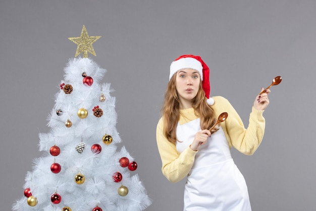 Expressive young woman posing for winter holidays