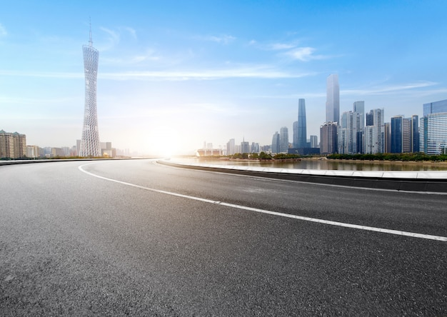 The expressway and the modern city skyline are in guangzhou, china.