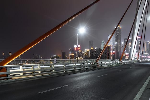Expressway on yangtze river bridge and modern city scenery in chongqing, china