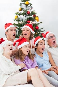 Extended family singing carols