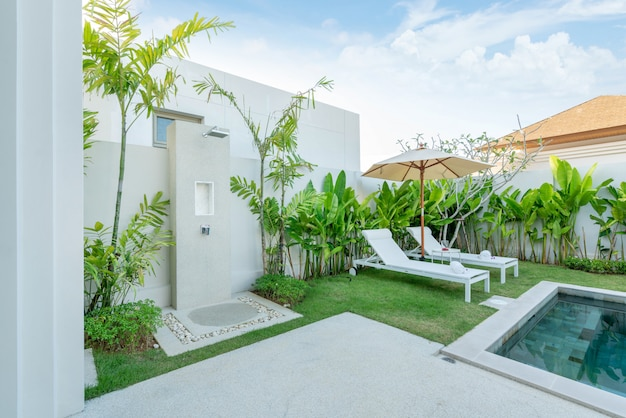 Exterior design outdoor table by  and sun bed or sun lounger  swimming pool