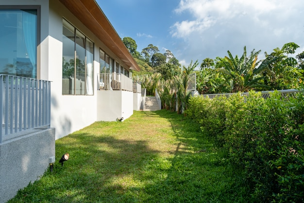 Exterior design of villa, house and home feature landscape and green garden beside the house