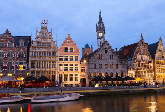 Exterior of illuminated buildings with canal at night, ghent, belgium