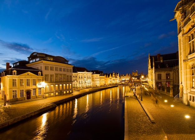Exterior of illuminated historic buildings with canal, ghent, belgium