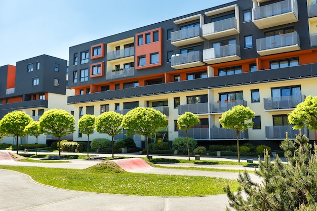 Exterior of a modern  apartment buildings on a blue sky