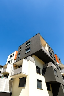 Exterior of a modern  apartment buildings on blue sky