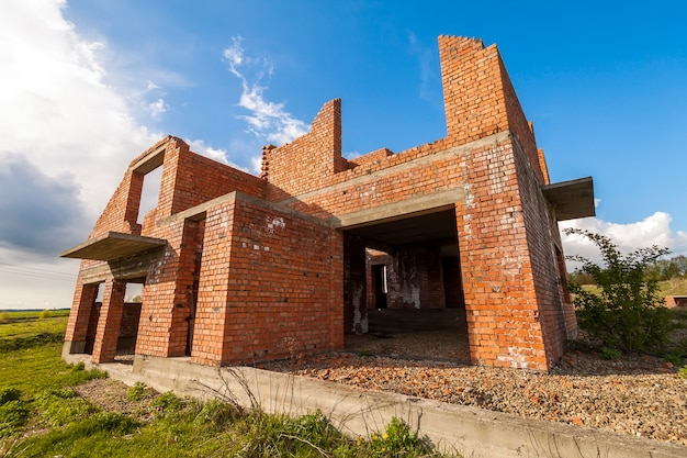 Exterior of an old building under construction. orange brick walls in a new house.