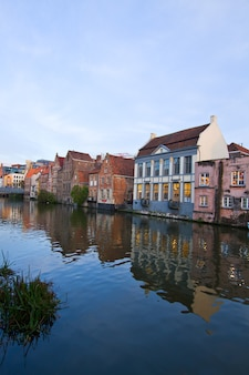 Exterior of old buildings with canal in ghent, belgium