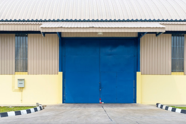 Exterior view of a warehouse building with a blue sky