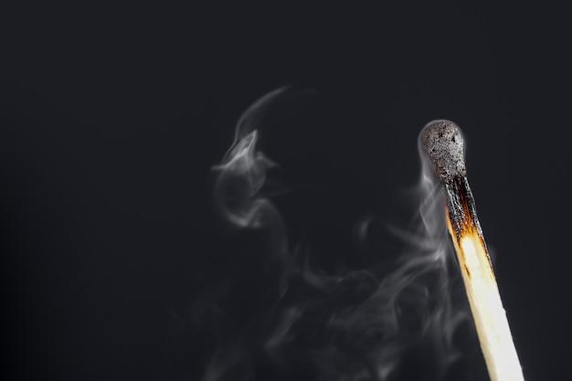 Extinguished match with smoke
