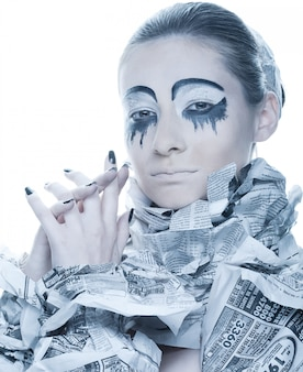Extravagant woman with dress paper news.